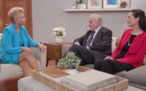 Joan Lunden with a man and woman talking on a couch